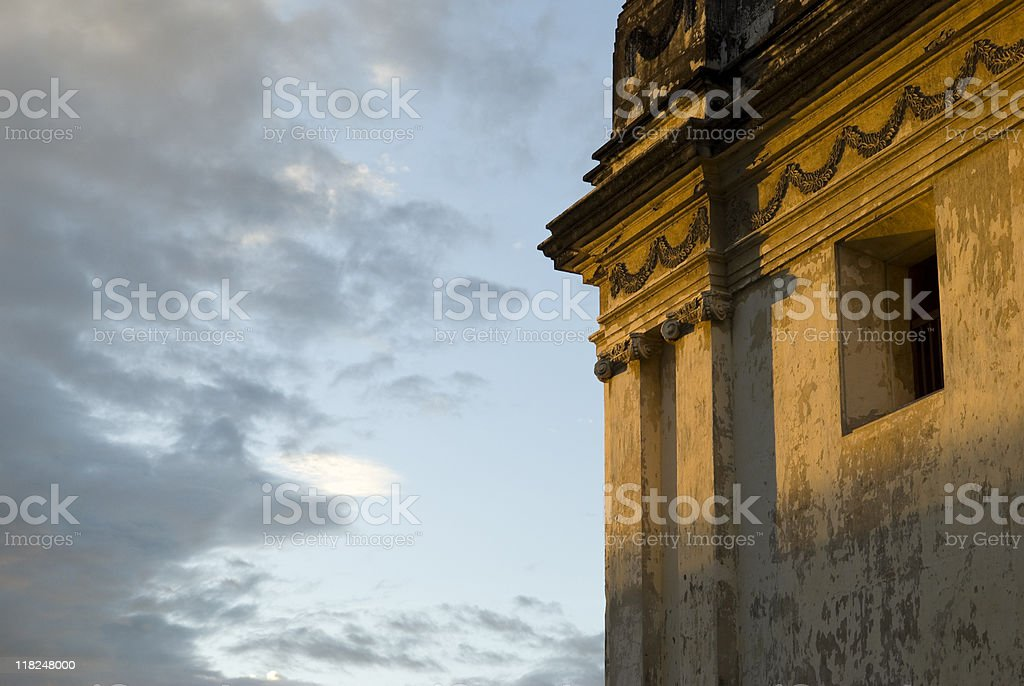 Sunset against Fading Colonial Architecture stock photo