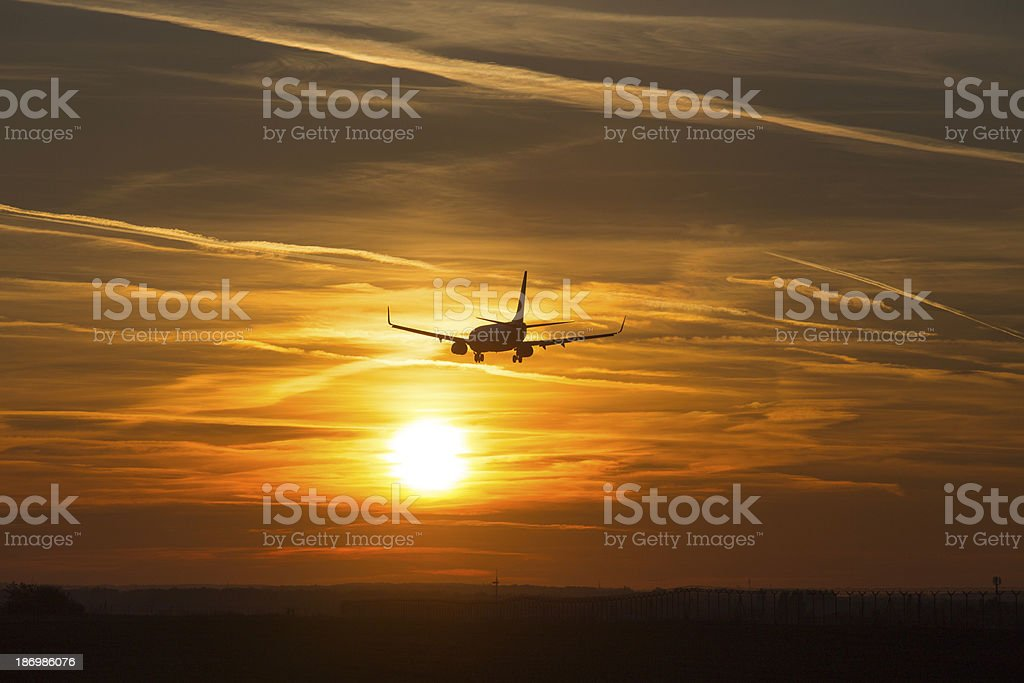 Sunset airplane royalty-free stock photo