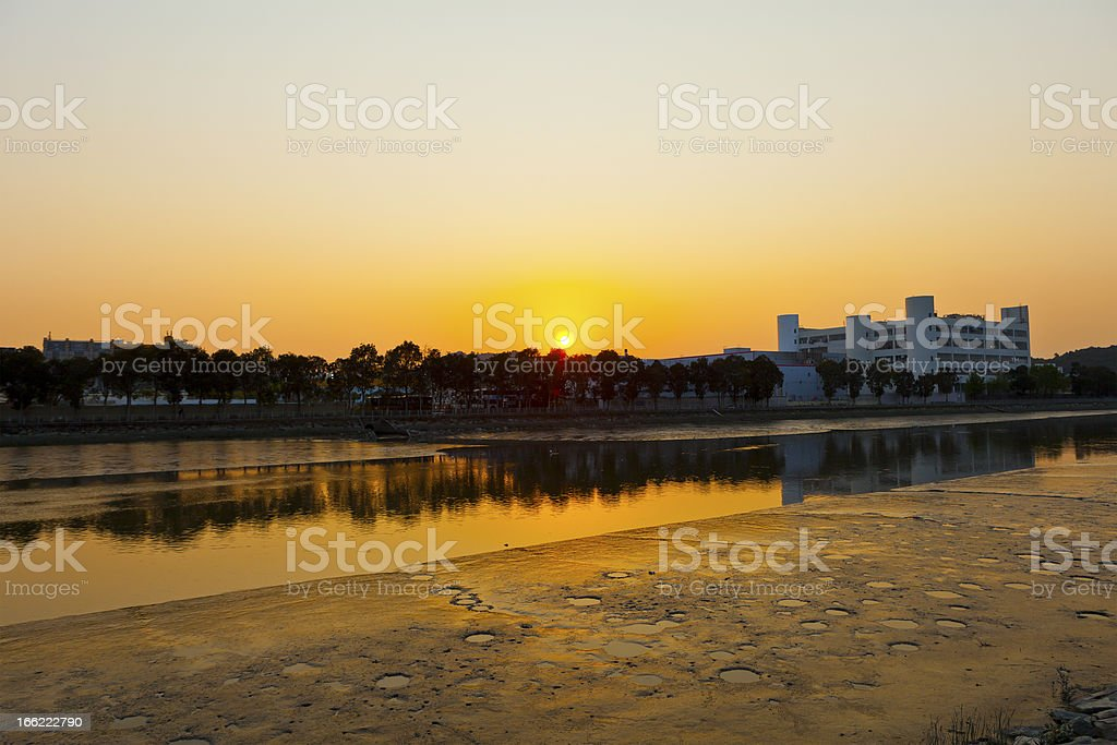 Sunset along river at factories royalty-free stock photo