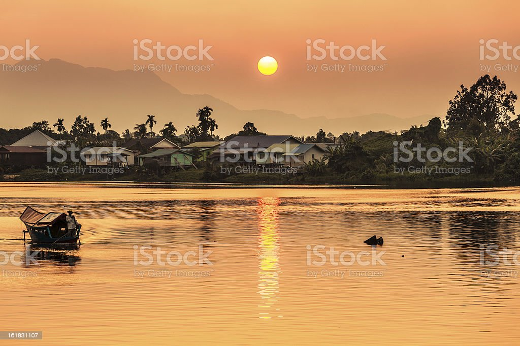 Sunset along river in Kuching, Borneo stock photo