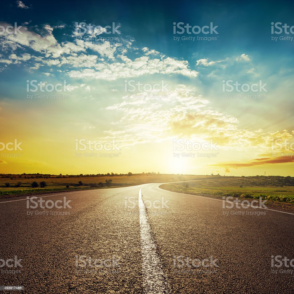 sunset and asphalt road stock photo