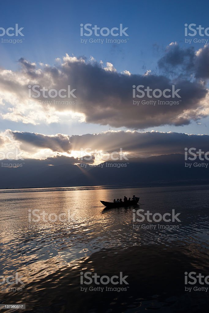 Sunset and boat silhouette on the sea stock photo