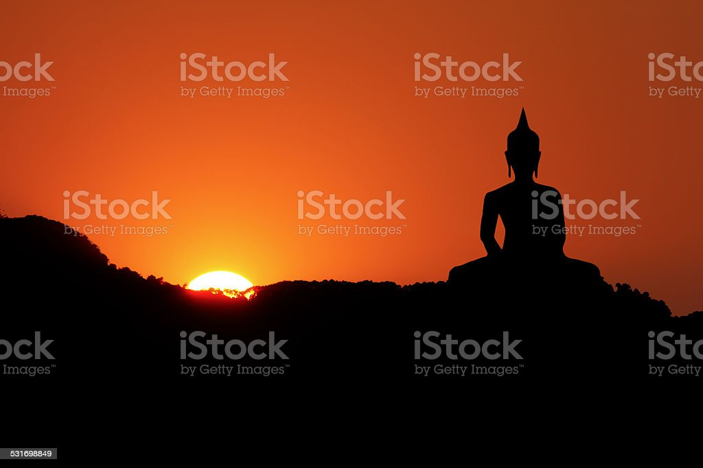 Sunset and Buddha iamge stock photo
