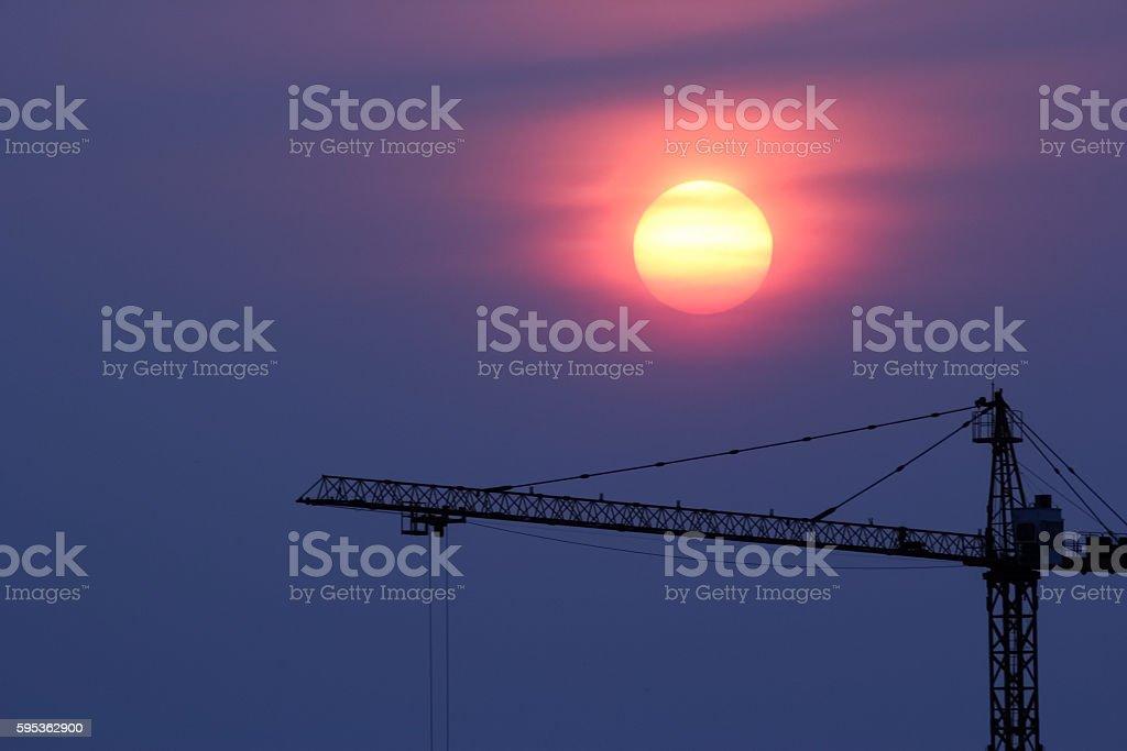 sunset and crane stock photo