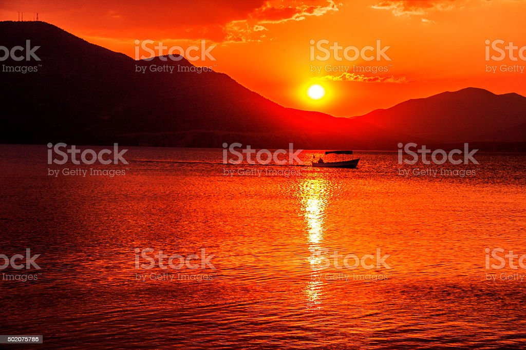 Sunset and fishing boat. stock photo