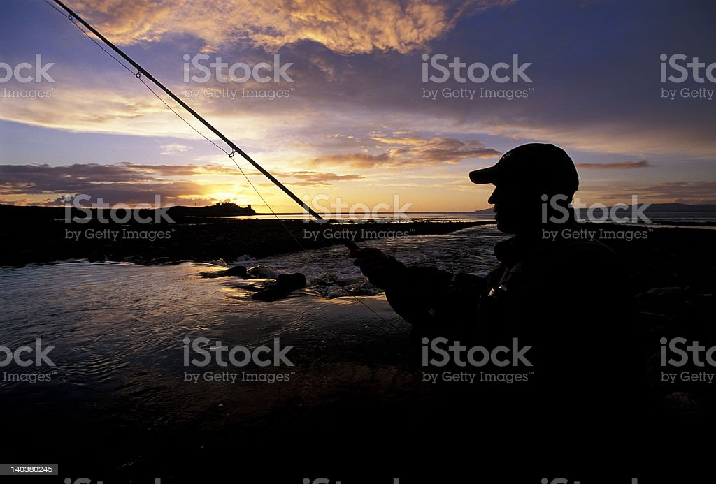 sunset and Fly fisherman royalty-free stock photo