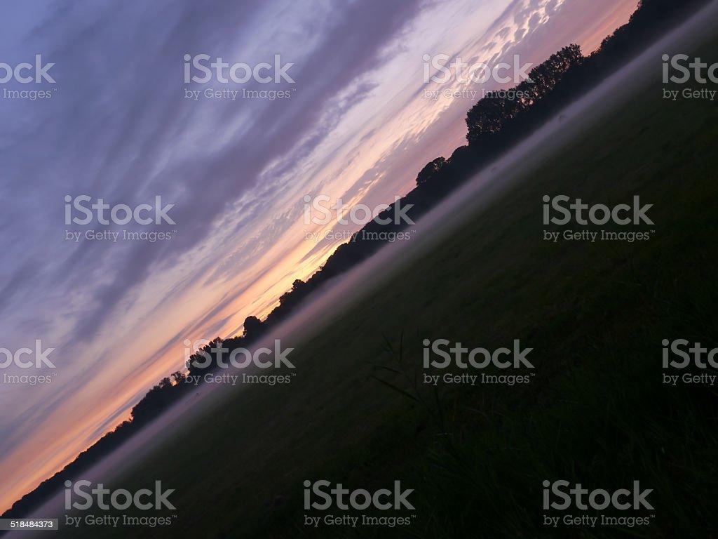 Sunset and fog diagonal royalty-free stock photo