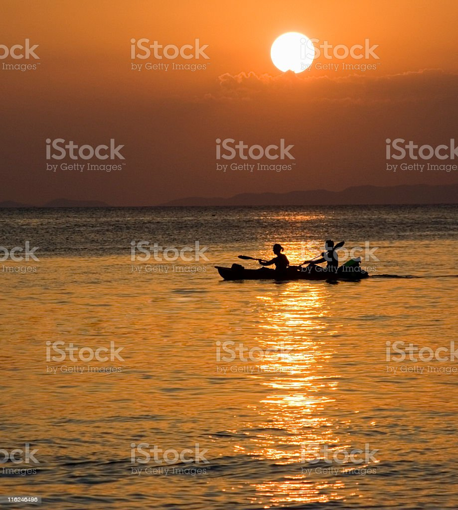 sunset and kayakers royalty-free stock photo