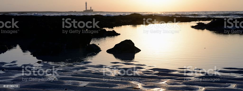 sunset and lighthouse stock photo