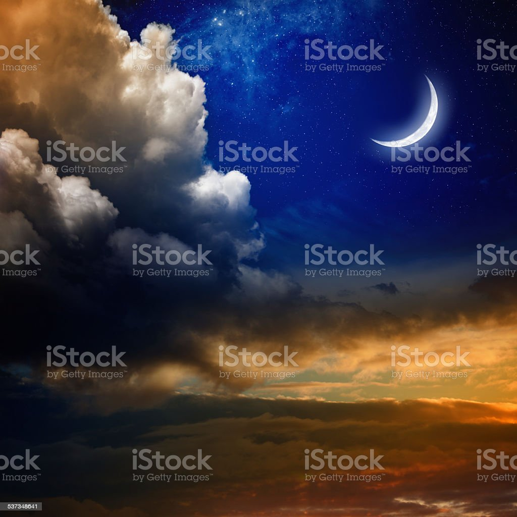 Sunset and new moon stock photo