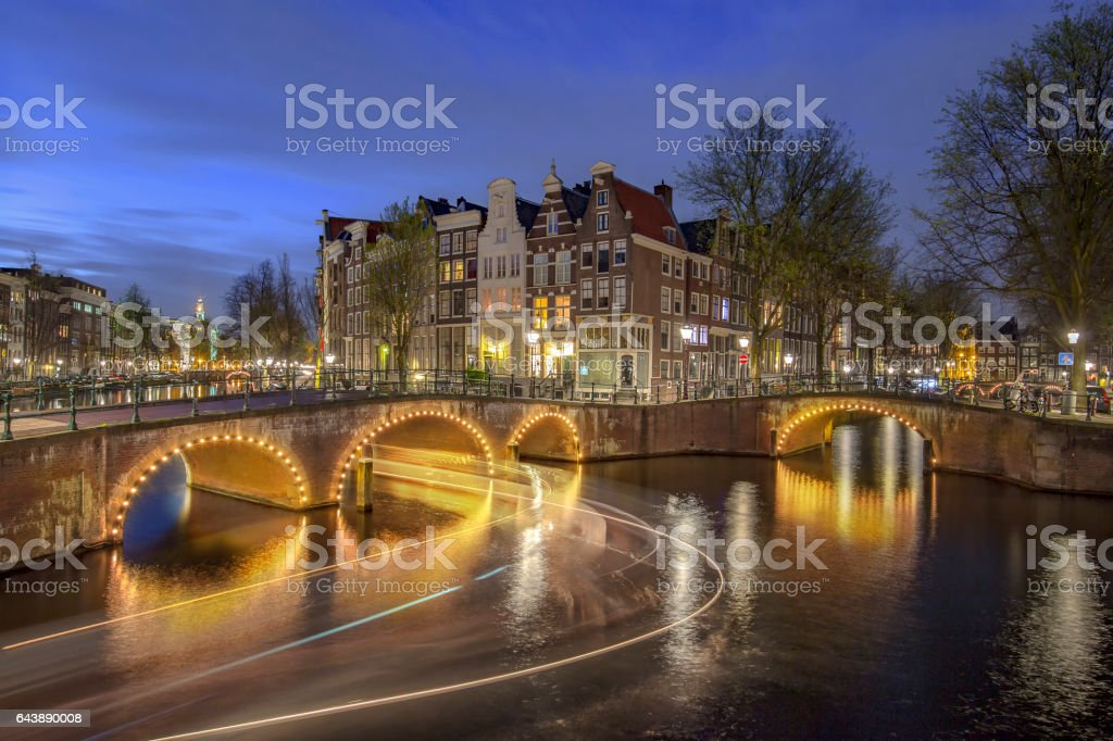 Sunset and night  at the intersection of Leidsegracht and Princengracht in Amsterdam stock photo