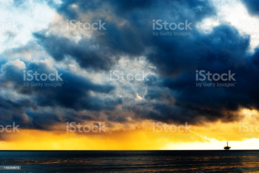 sunset and oil rig stock photo