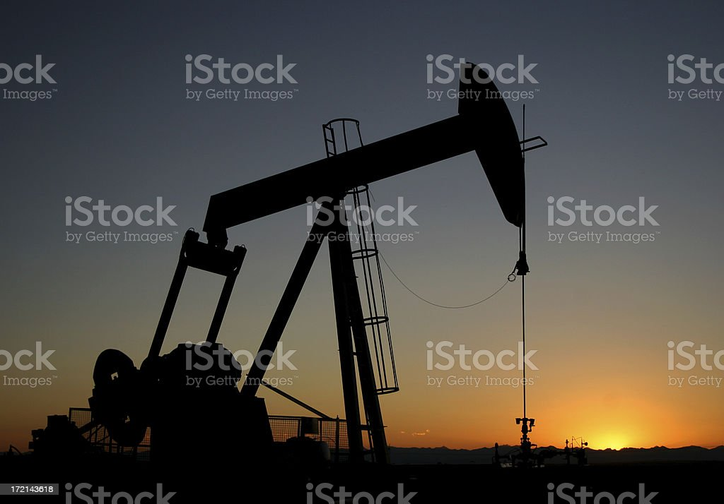 Sunset and Oil Rig Silhouette stock photo