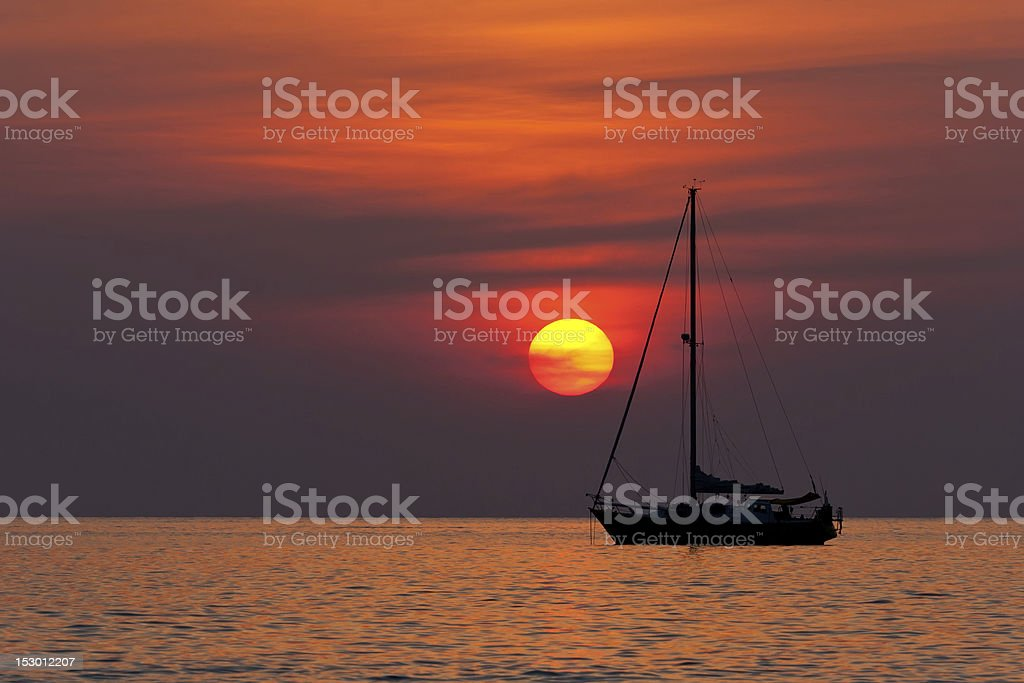sunset and sailboat royalty-free stock photo