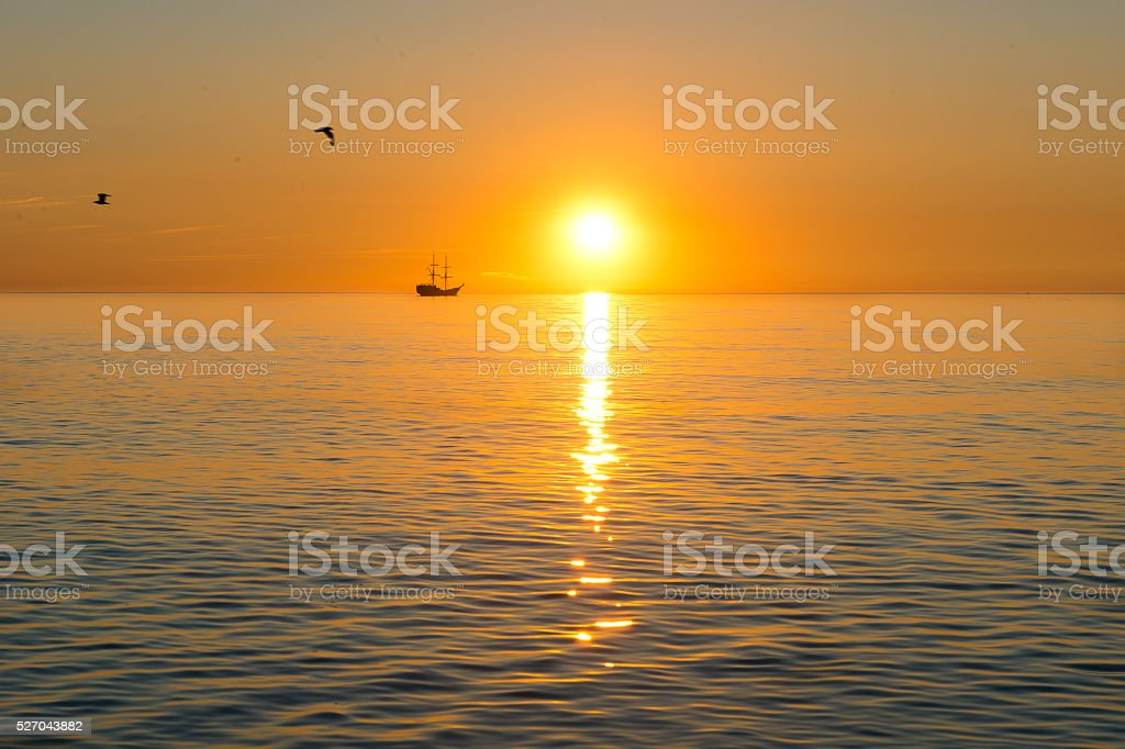 sunset and ship stock photo