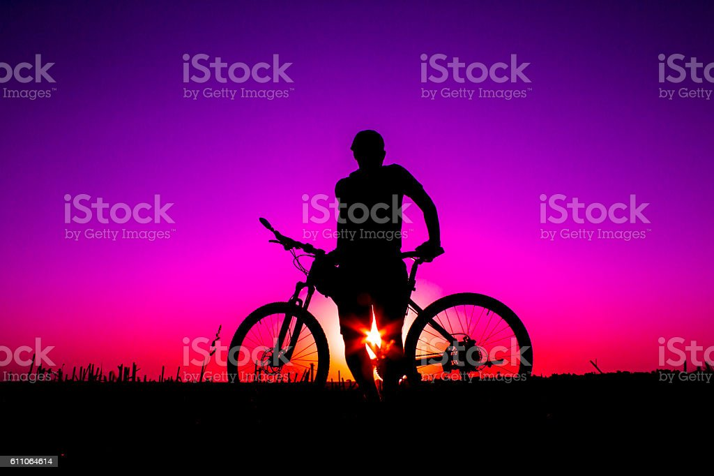 sunset and silhouette backlight bikers stock photo