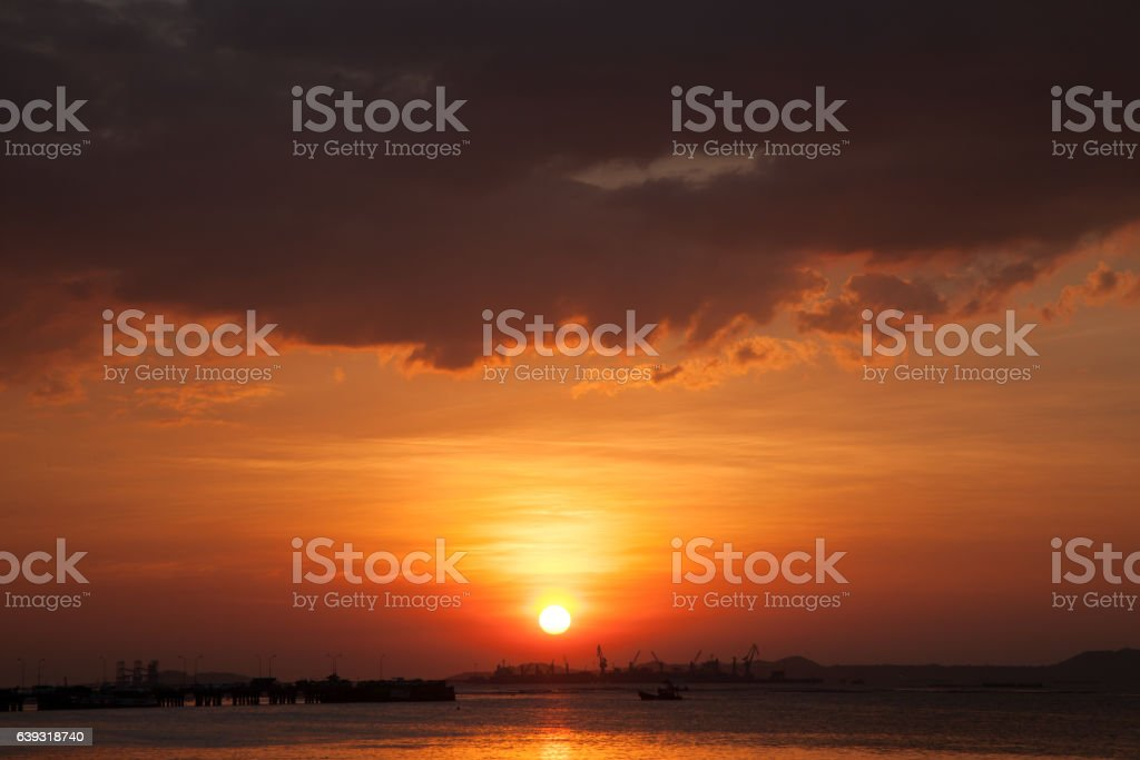 Sunset and storm cloud stock photo