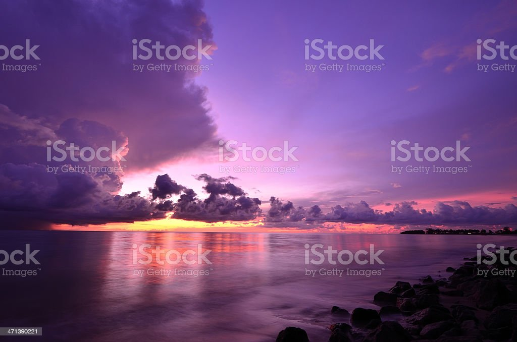Sunset and storm front with rain over the sea royalty-free stock photo