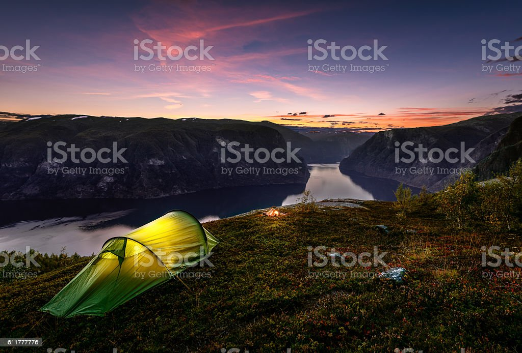 Sunset and Tent in Autumn in Aurlandsfjord, Norway stock photo