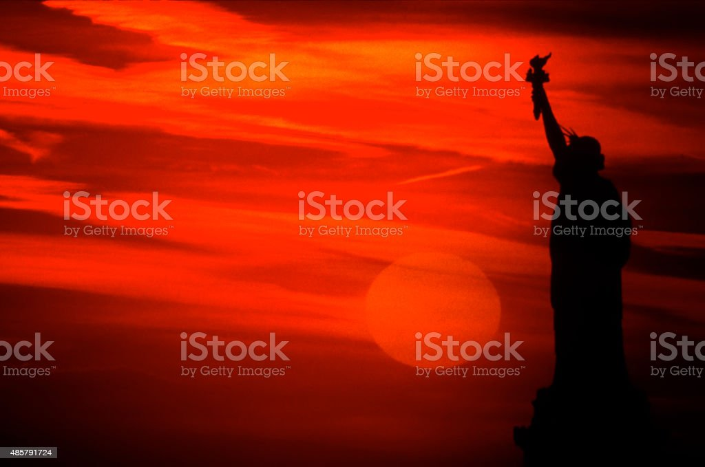 Sunset And The Statue of Liberty Silhouette stock photo