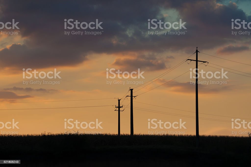 sunset and three electric pylons royalty-free stock photo