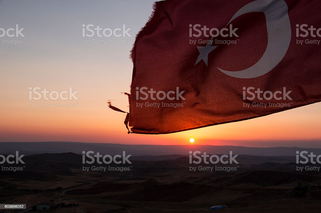 Sunset and Turkish flag stock photo