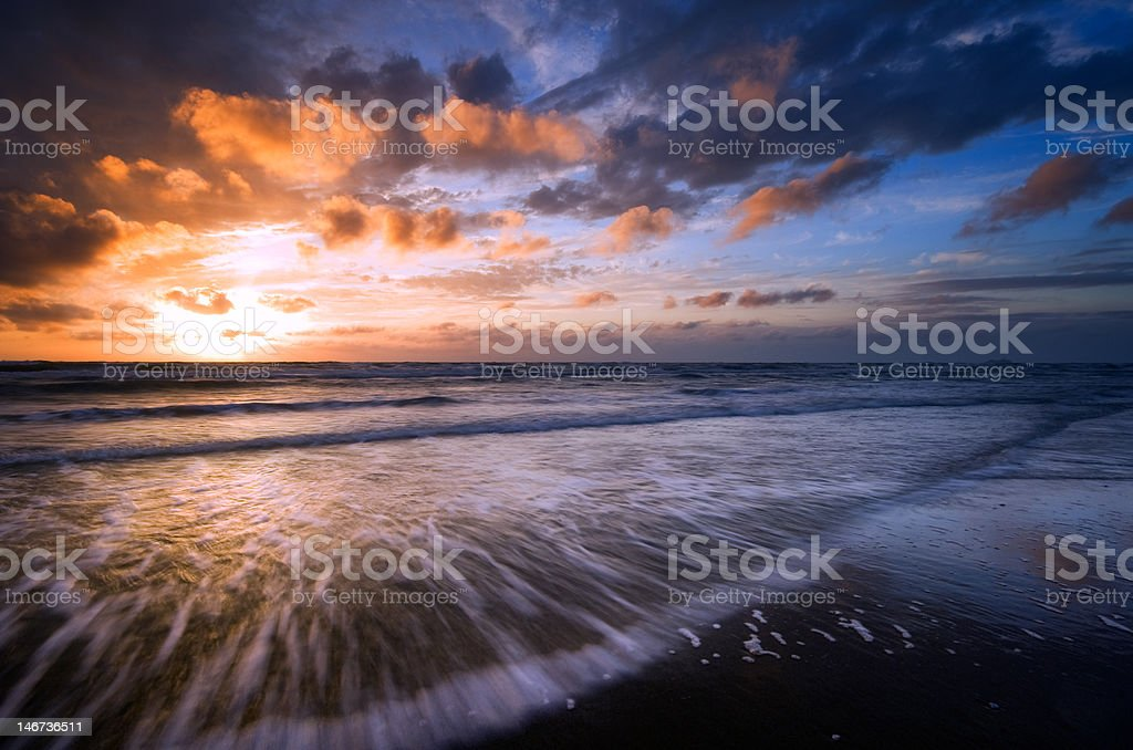 sunset and waves royalty-free stock photo