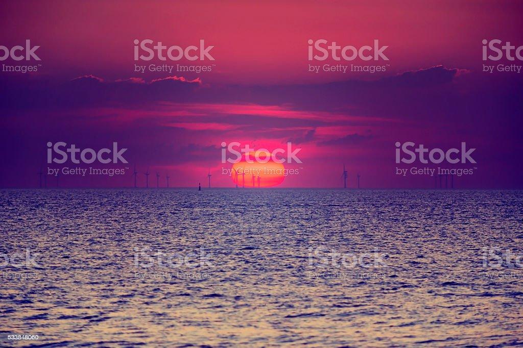 Sunset and wind farm, Margate, England stock photo