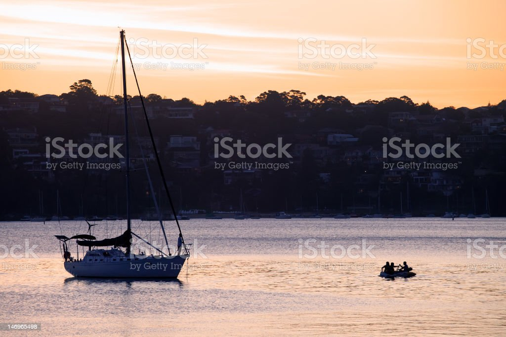 Sunset and Yacht on Manly Cove royalty-free stock photo
