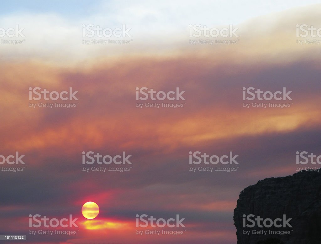 Sunset Arizona Clouds Smoke Courthouse Butte stock photo