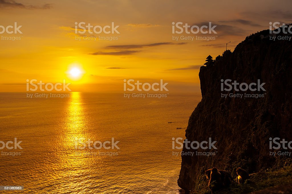 Sunset at a cliff in Bali Indonesia. stock photo