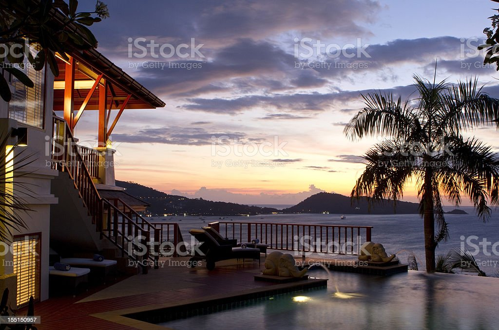 Sunset at a luxurious swimming pool tropical villa royalty-free stock photo