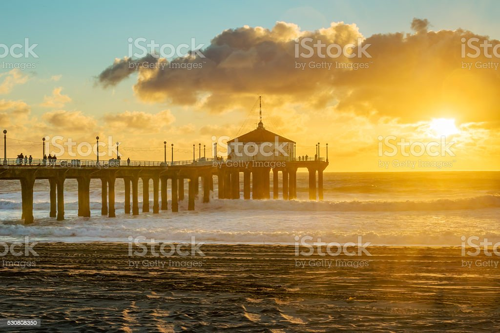 Sunset at a Pier on the Beach stock photo