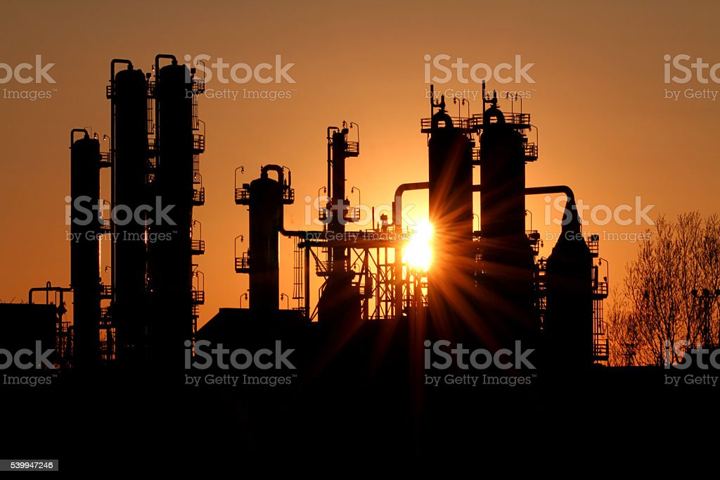 Sunset at a refinery stock photo