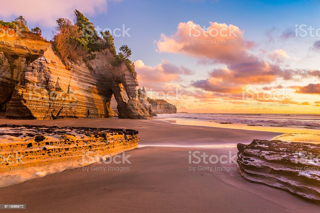 Sunset at a rocky beach stock photo