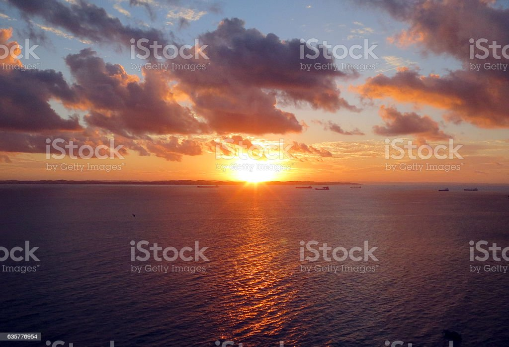 Sunset at Bay of All Saints stock photo