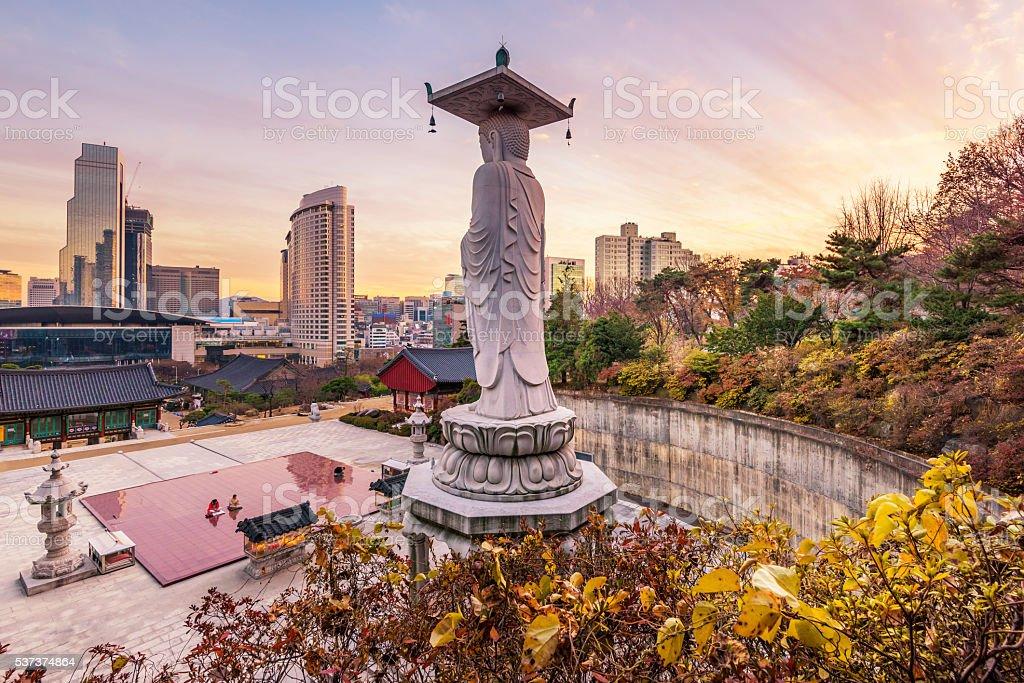 Sunset at Bongeunsa temple of downtown skyline stock photo