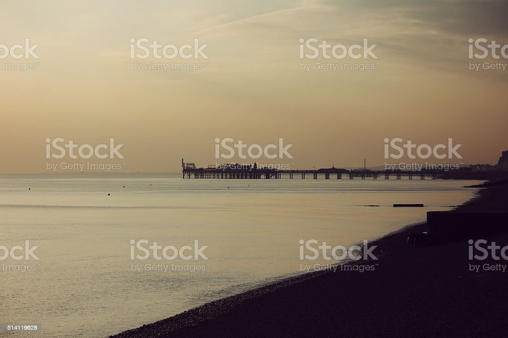 sunset at brighton pier stock photo