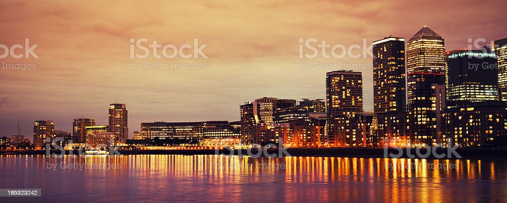 Sunset at Canary Wharf on Thames River in London royalty-free stock photo