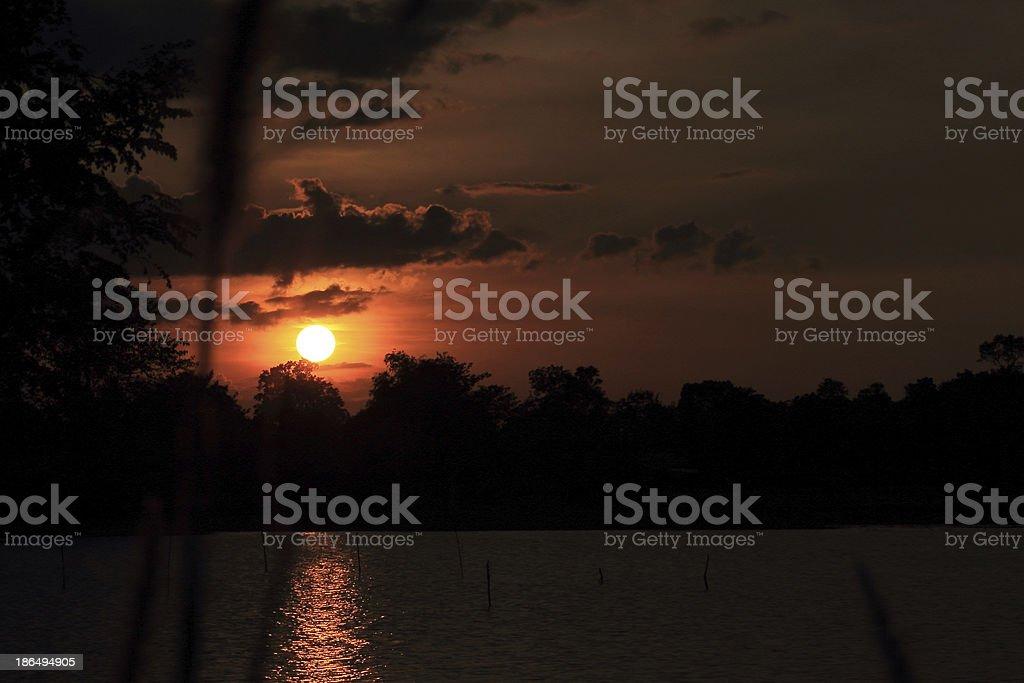 Sunset at coast of the lake royalty-free stock photo