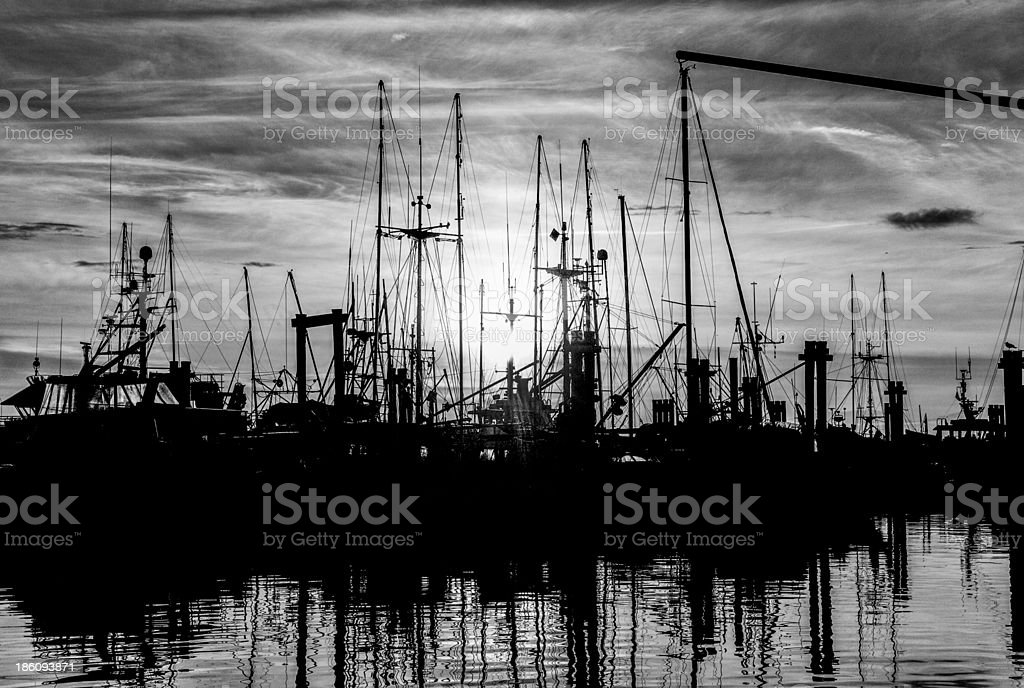 sunset at fishing wharf stock photo