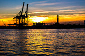 sunset at Genoa's port, silhouette of the Lanterna, Italy