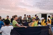 Sunset at Greek refugee camp as volunteers start serving supper