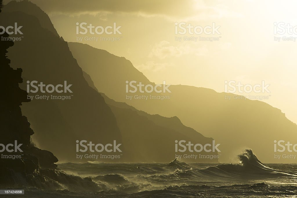 Sunset at Kee beach, Hawaii with mountains in background stock photo