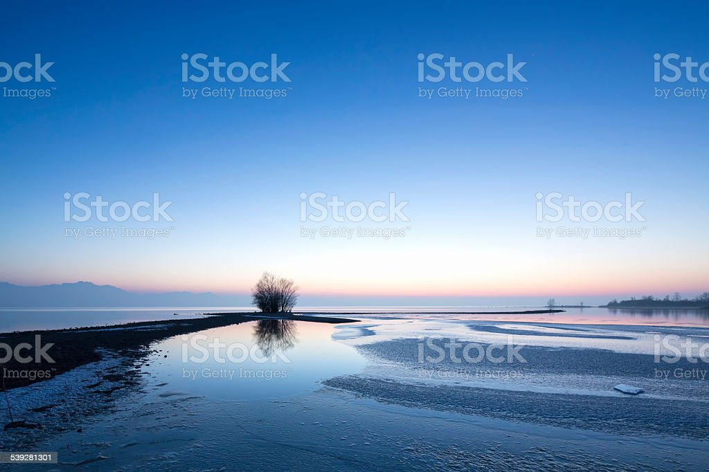 Sunset at lake Chiemsee in Germany in winter stock photo