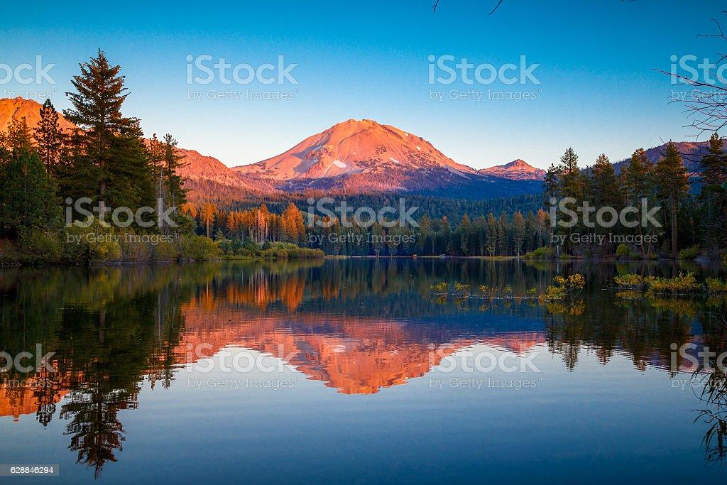 Sunset at Lassen Peak with reflection on Manzanita Lake stock photo