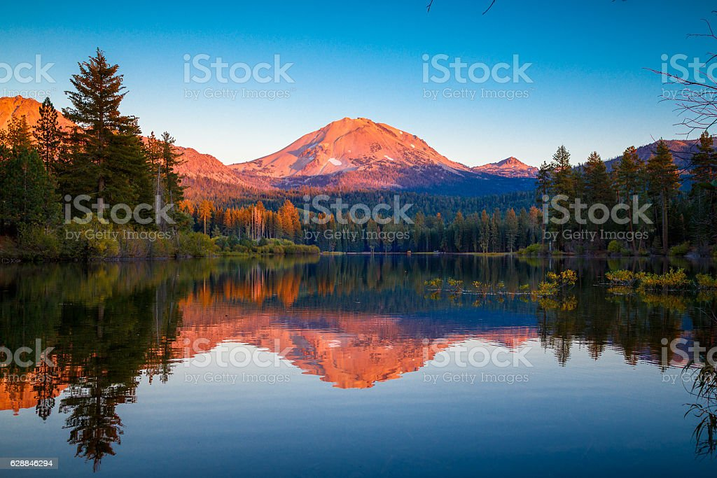 Sunset at Lassen Peak with reflection on Manzanita Lake stock photo