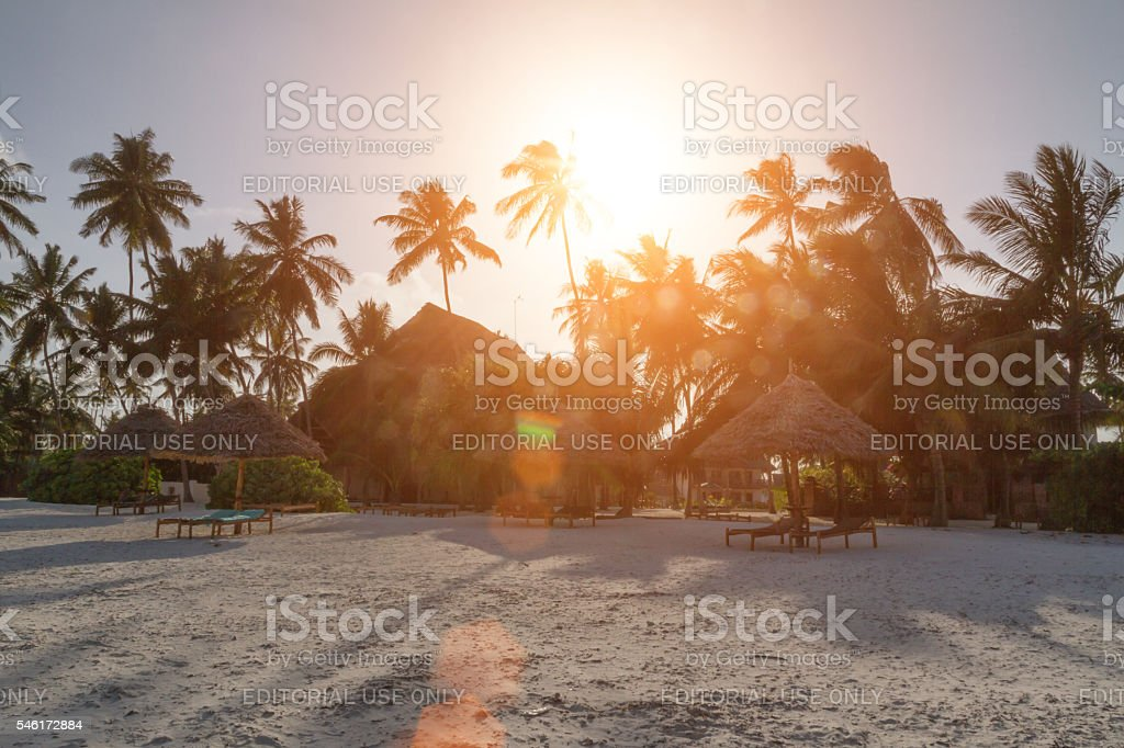 Sunset at low tide with resort in background - Zanzibar stock photo