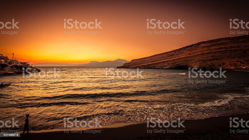 Sunset at Matala beach on Crete island, Greece stock photo
