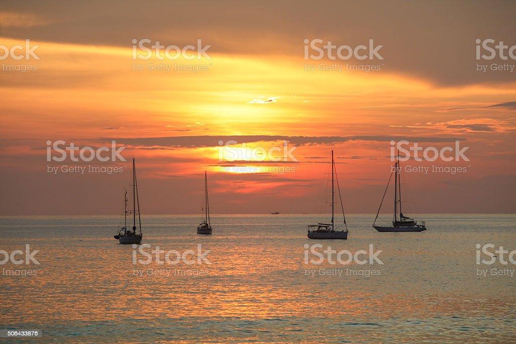 Sunset at Nai Harn beach on Phuket in Thailand stock photo